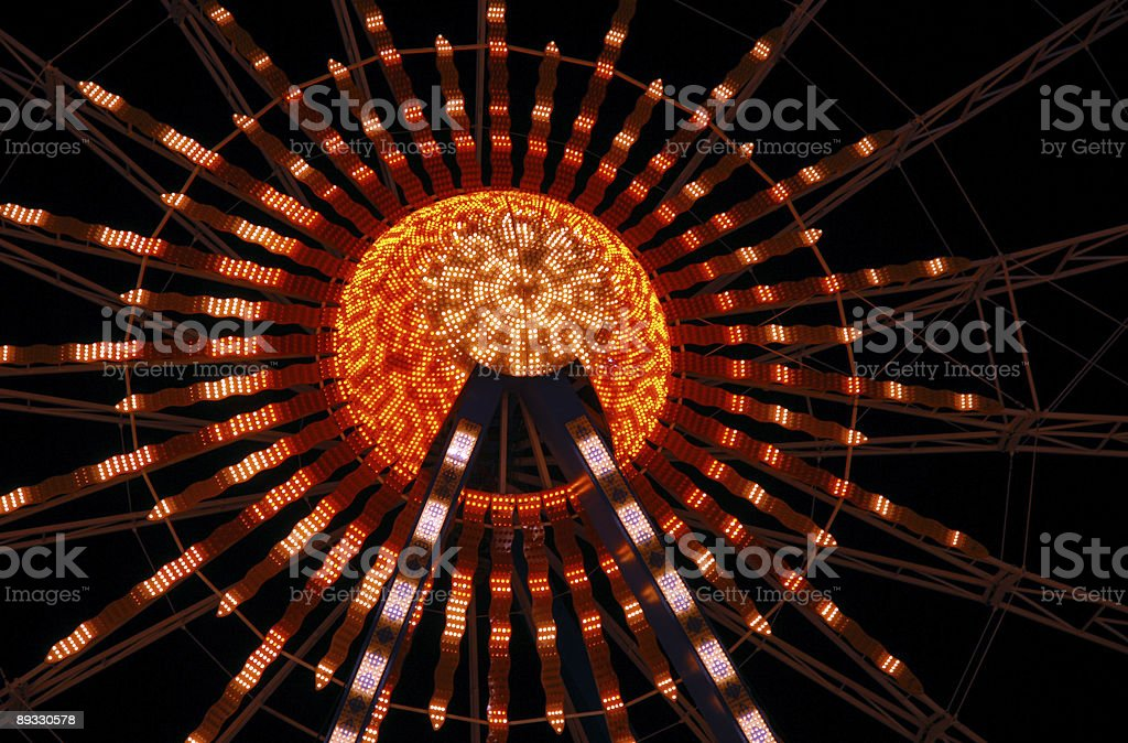 Colorful rays of a giant wheel stock photo