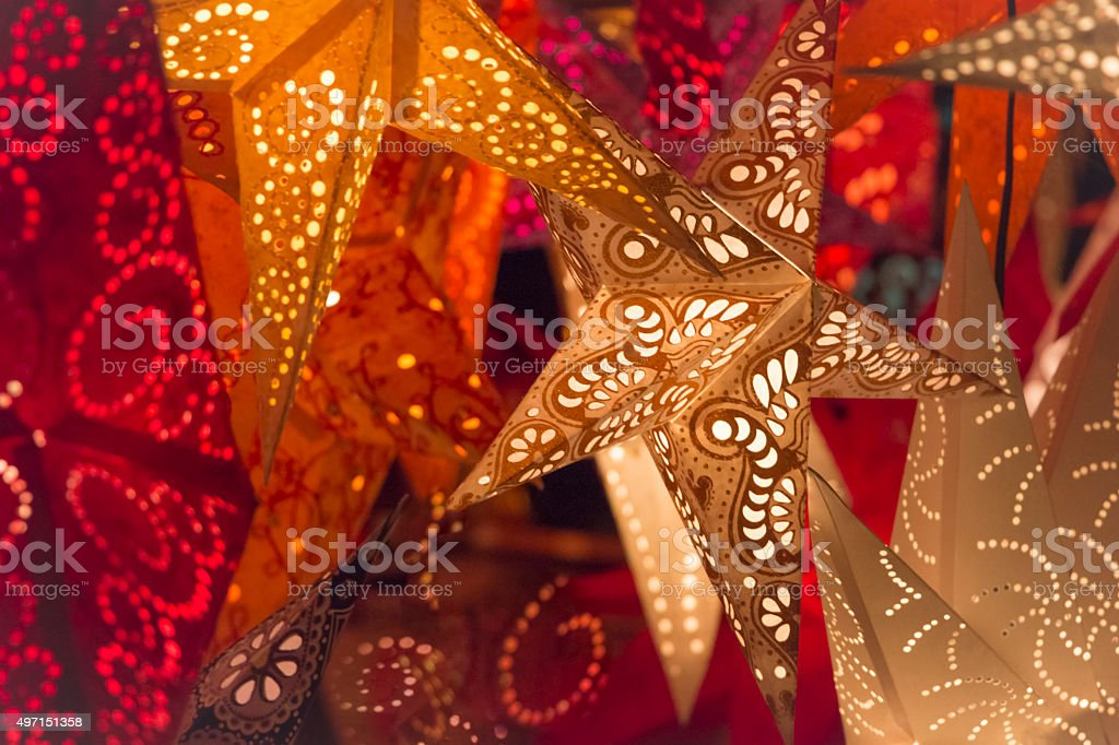 Colorful red golden orange xmas stars at christmas market stock photo