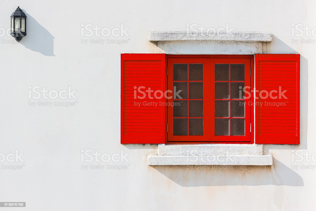 Colorful red window and Detail of house exterior. stock photo