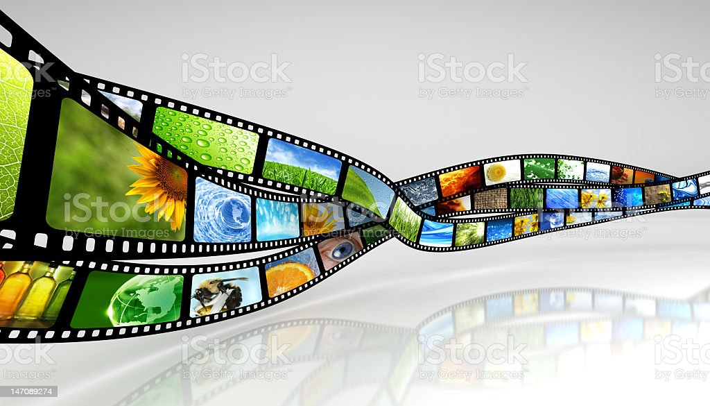 Colorful reel of photographic film stock photo