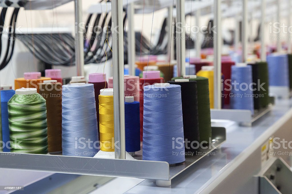 Colorful reels of threads background stock photo