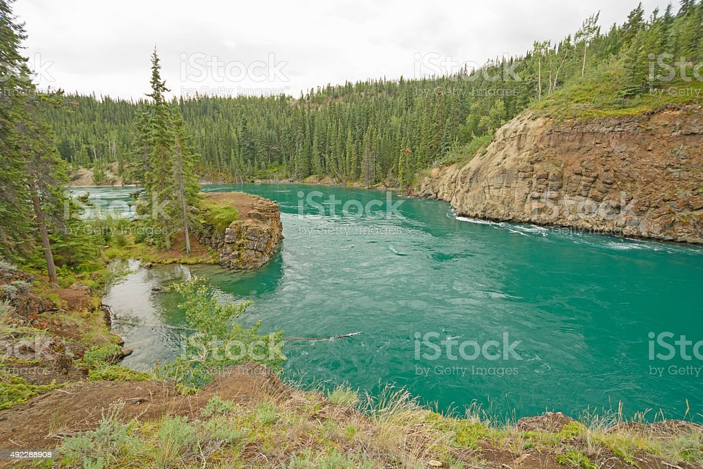 Colorful River entering a Canyon stock photo