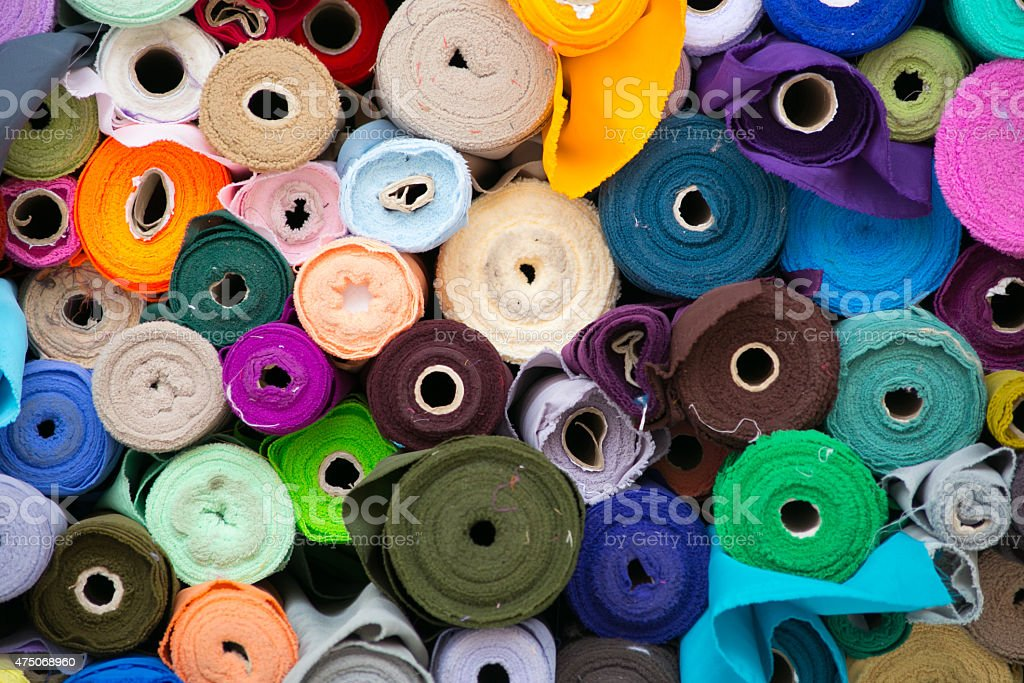 Colorful roll of Fabrics. stock photo