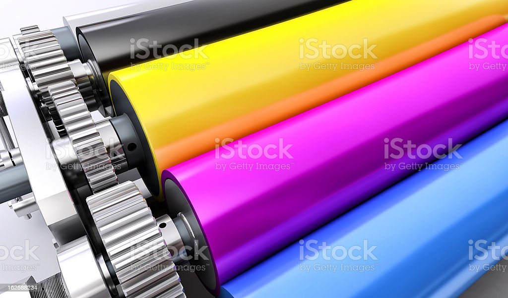 Colorful rolls of a printing machine stock photo