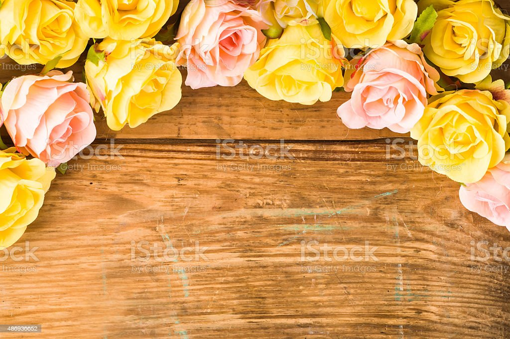 Colorful roses flowers, floral background on a vintage wood background. stock photo