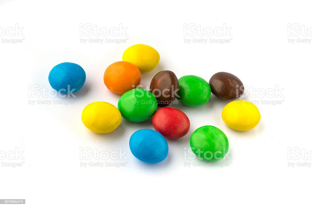 colorful round candies on a white background stock photo