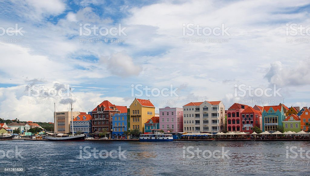 colorful row of houses stock photo