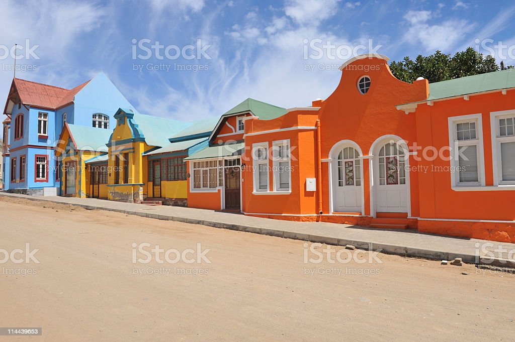 Colorful row orange,blue,yellow houses in Luderitz, Namibia stock photo