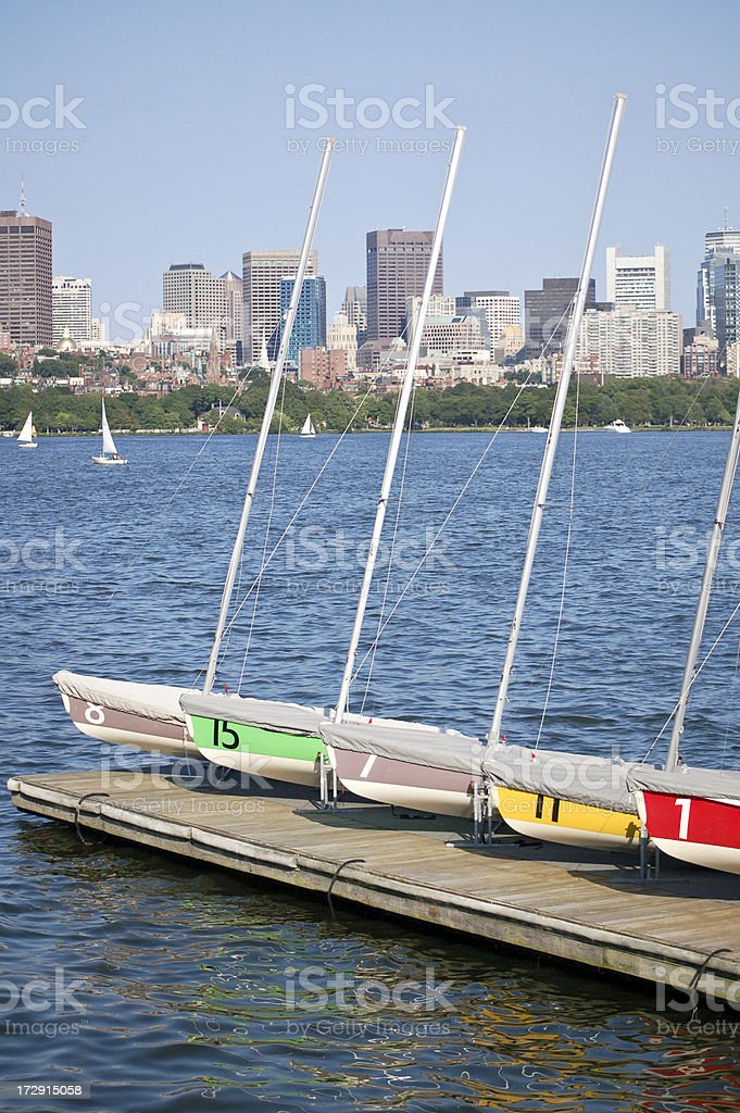 Colorful sailboats waiting to go on the Charles River royalty-free stock photo
