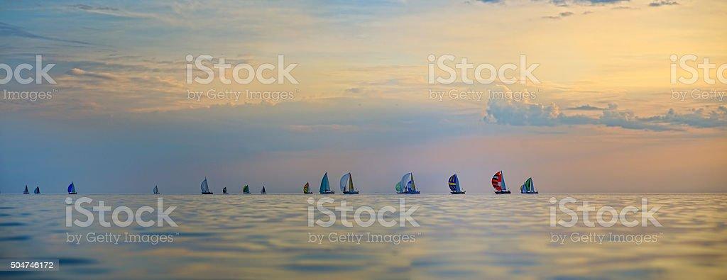 Colorful sailing boats on the sea stock photo