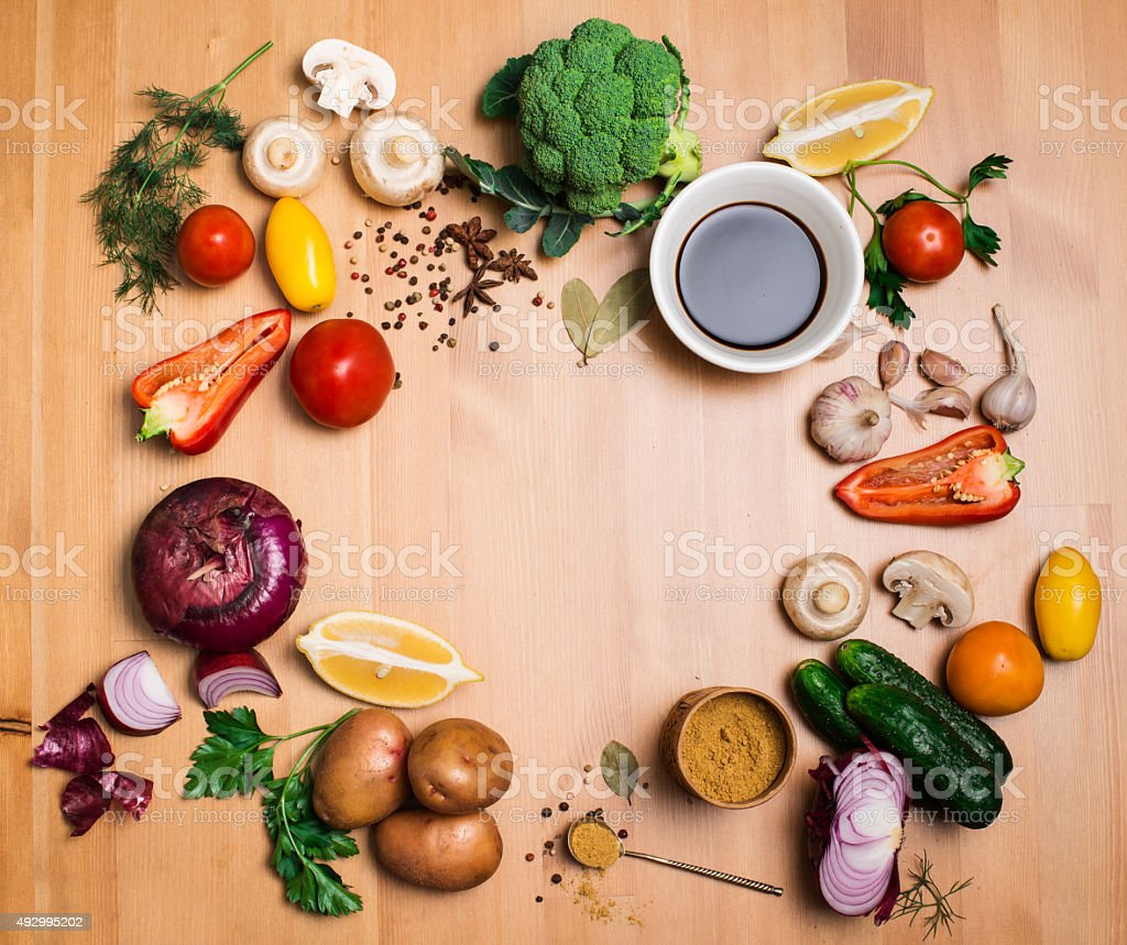 Colorful salad ingredients on rustic wooden background with copy space. stock photo