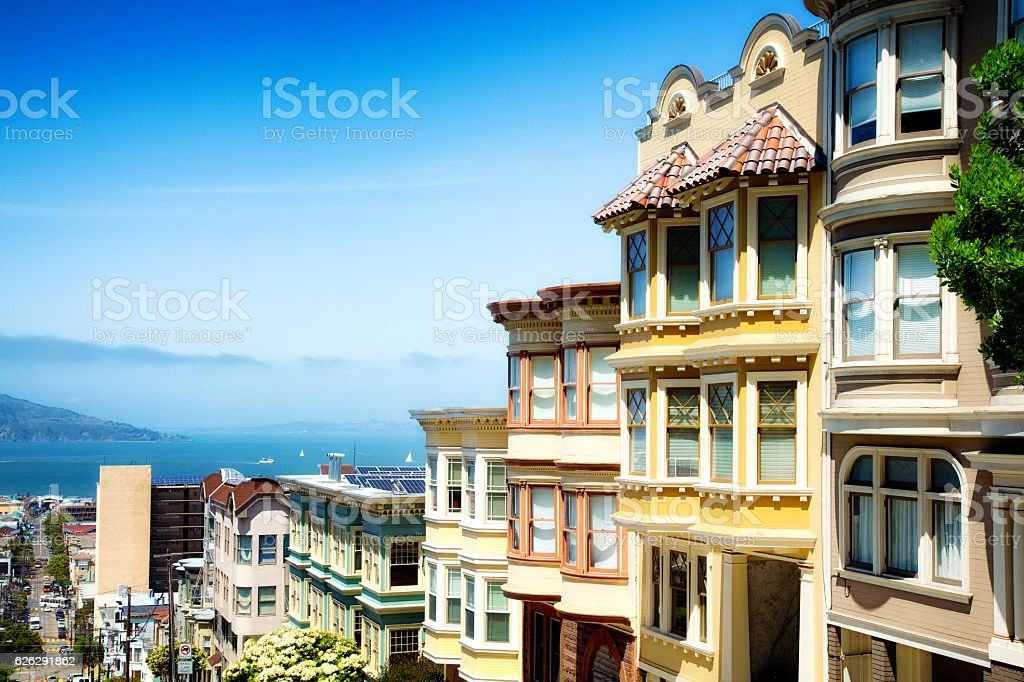 colorful san francisco building tops with bay sunny day stock