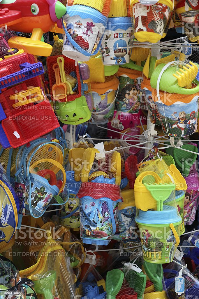Colorful sand pail and shovel on a store display royalty-free stock photo