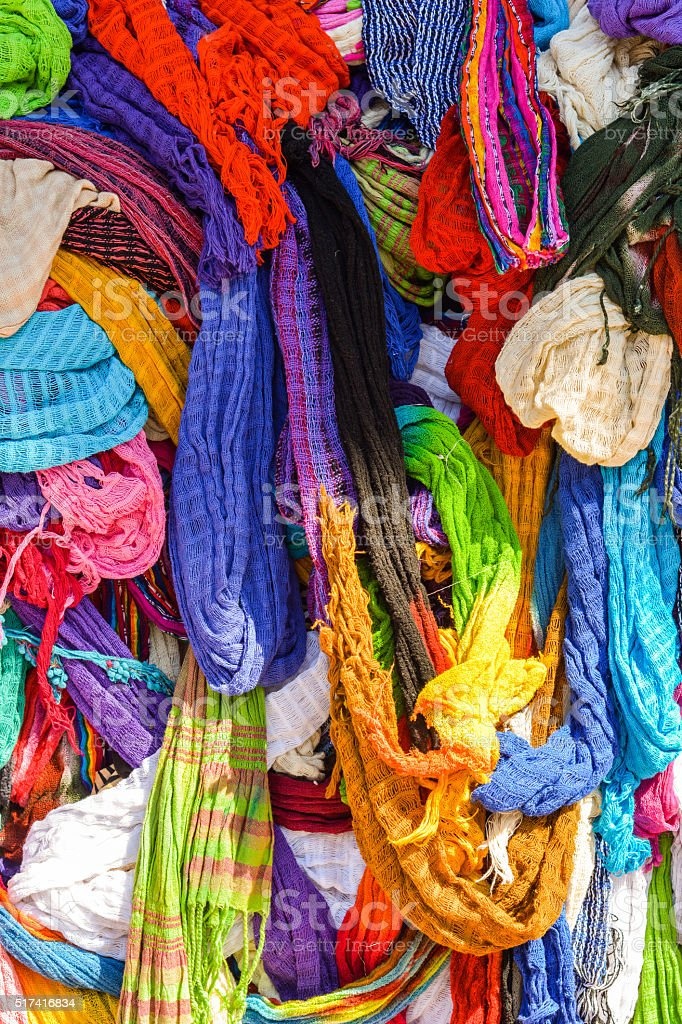 Colorful Scarves in Pile at Market in Mexico stock photo