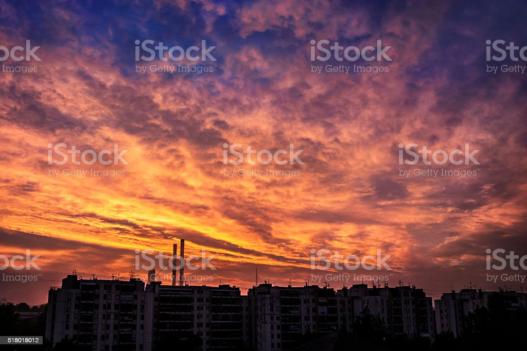 Colorful scattered clouds at sunrise - dramatic sky stock photo