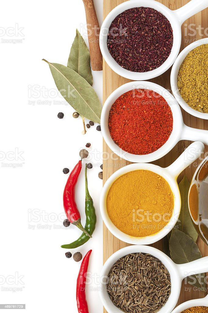 Colorful selection of various spices with leaves and peppers stock photo