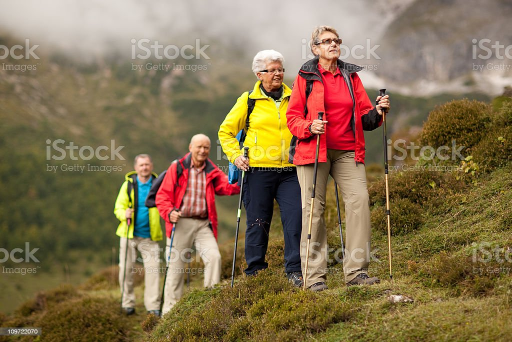 colorful senior hiking group royalty-free stock photo