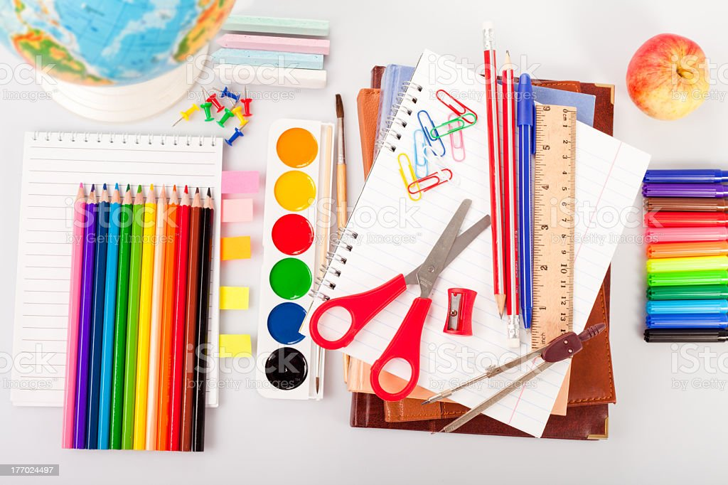Colorful set of school supplies set on a white desk royalty-free stock photo