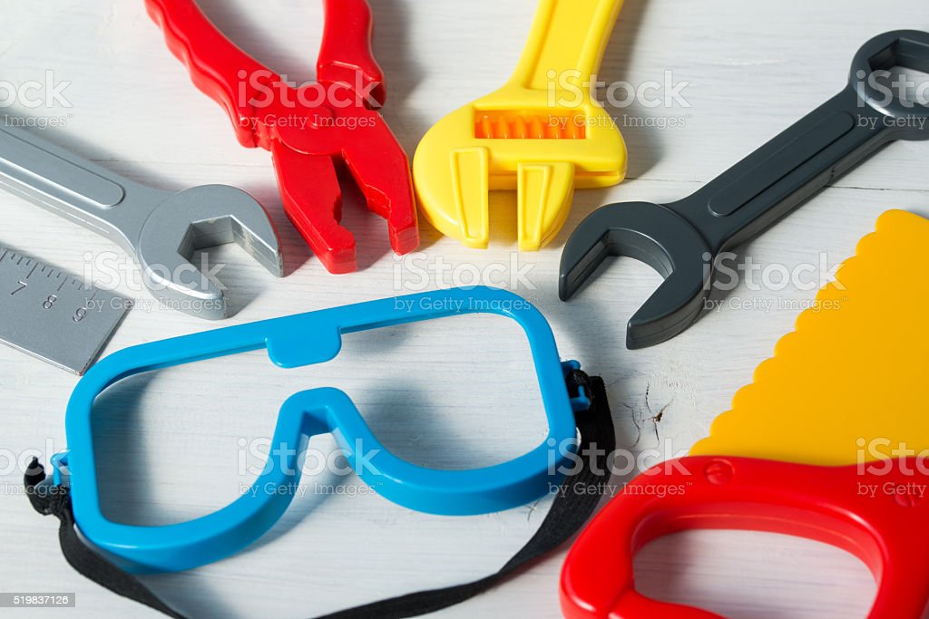 Colorful set of toy tools for children on a background stock photo