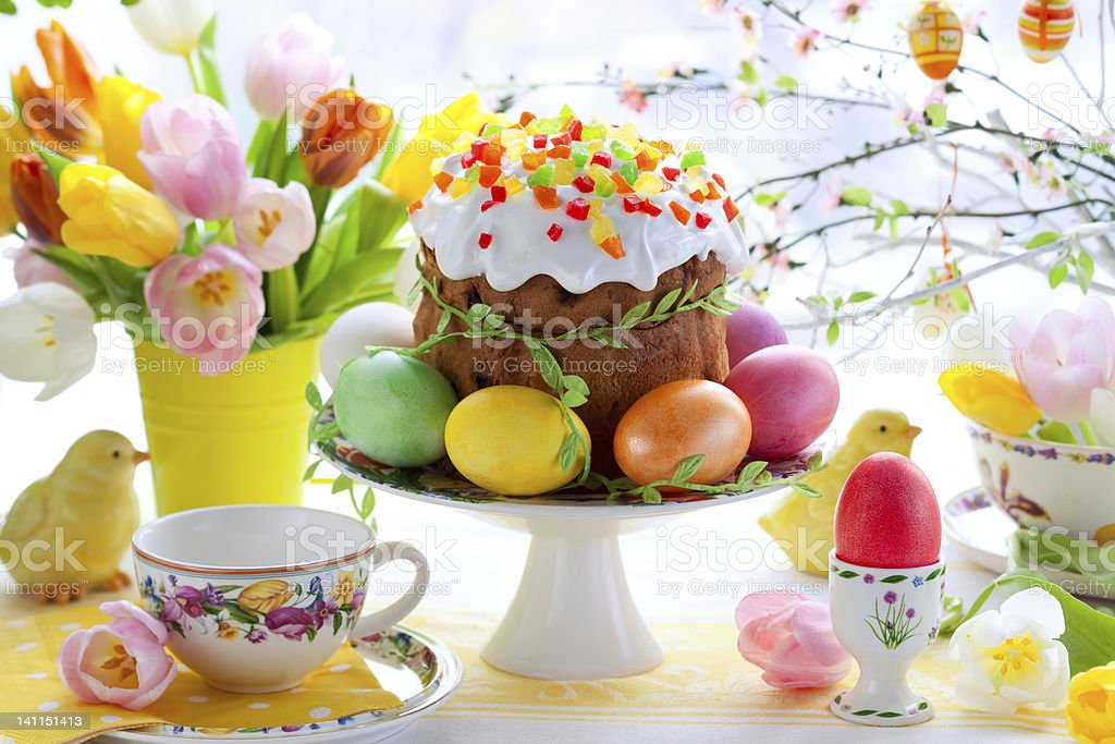 Colorful setting of Easter cake and eggs stock photo