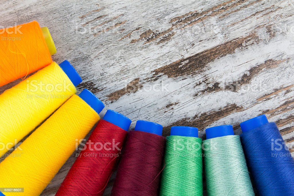 Colorful sewing coils background stock photo