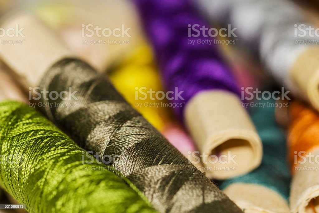 Colorful Sewing Thread Pattern. Colorful miniature bobbins of thread for sewing stock photo