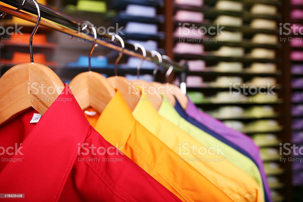 Colorful shirts in a store stock photo
