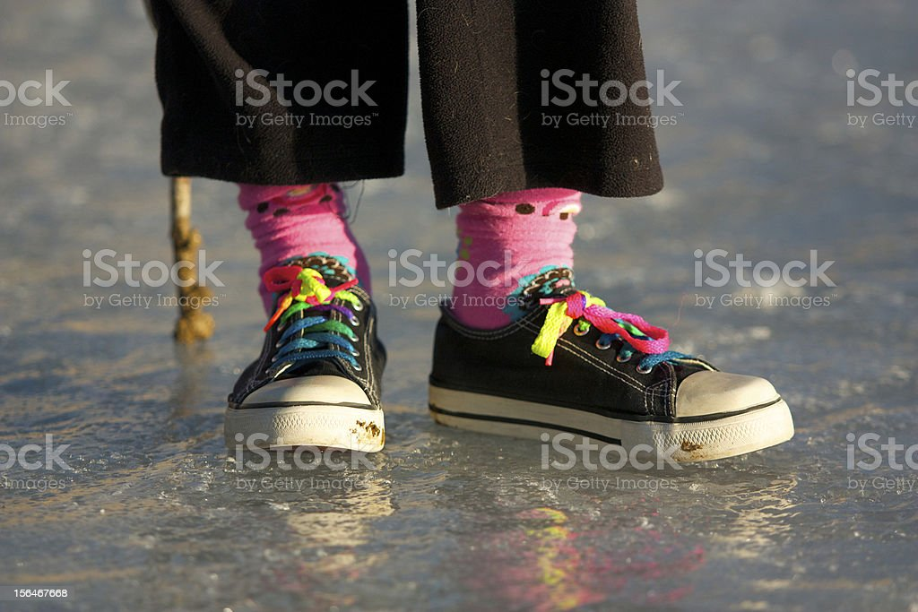 Colorful shoes and socks on ice royalty-free stock photo