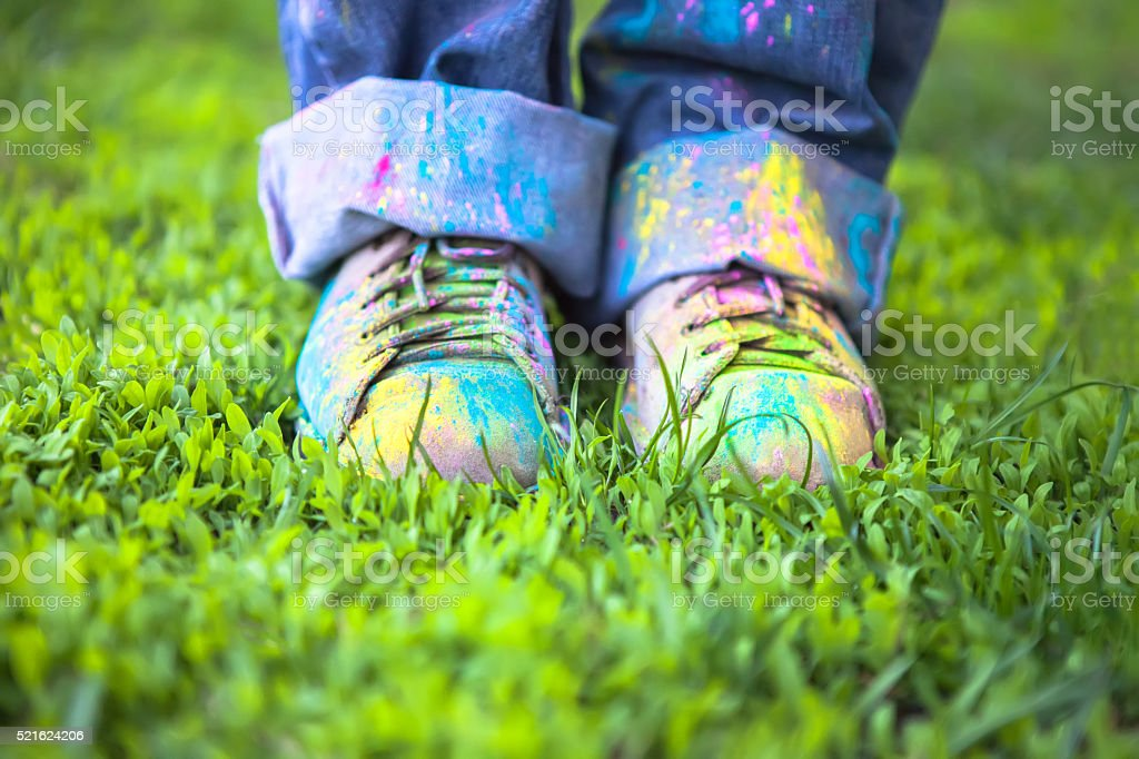 Colorful shoes on green grass stock photo