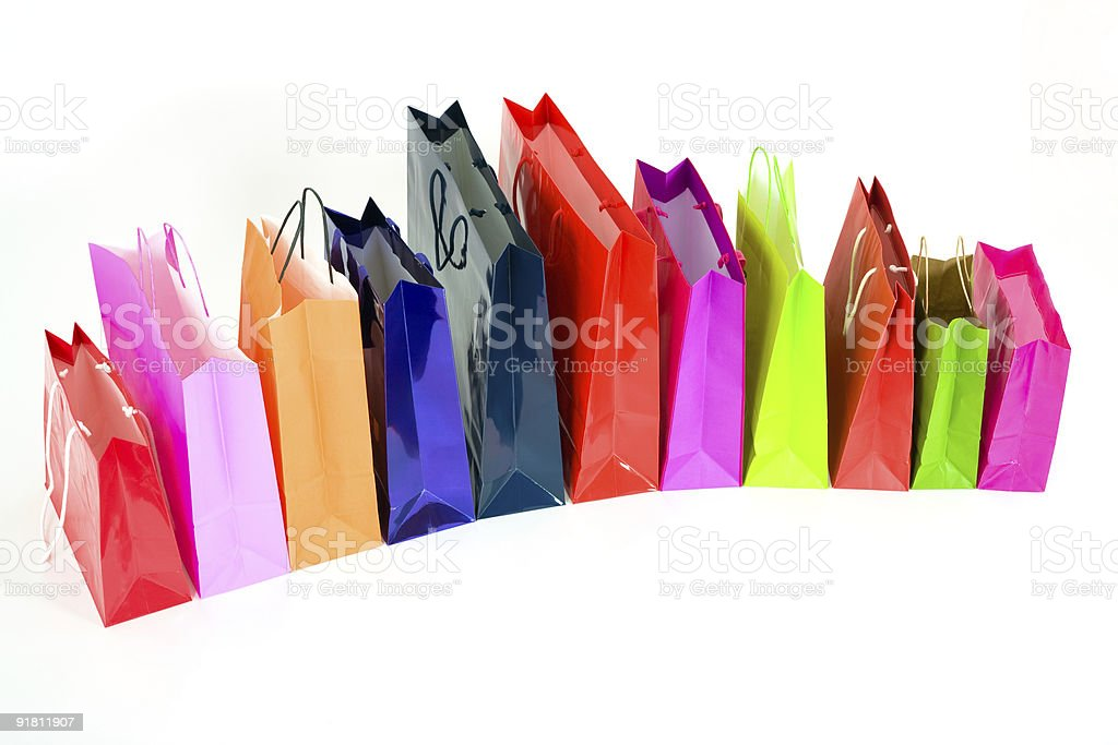 Colorful shopping bags in a row royalty-free stock photo