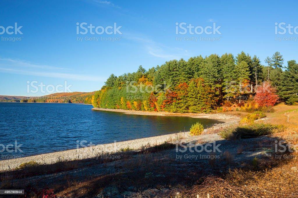Colorful shoreline of Barkhamsted Reservoir in October. stock photo