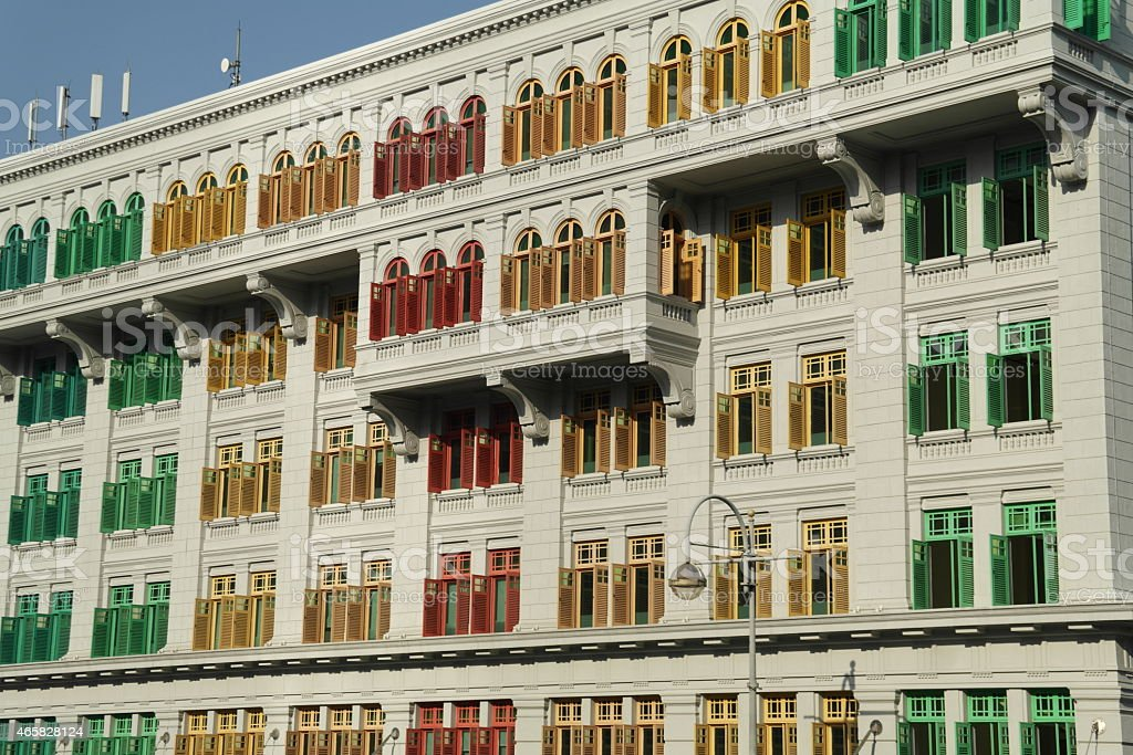 Colorful shutters of green, red, yellow in a big building  stock photo