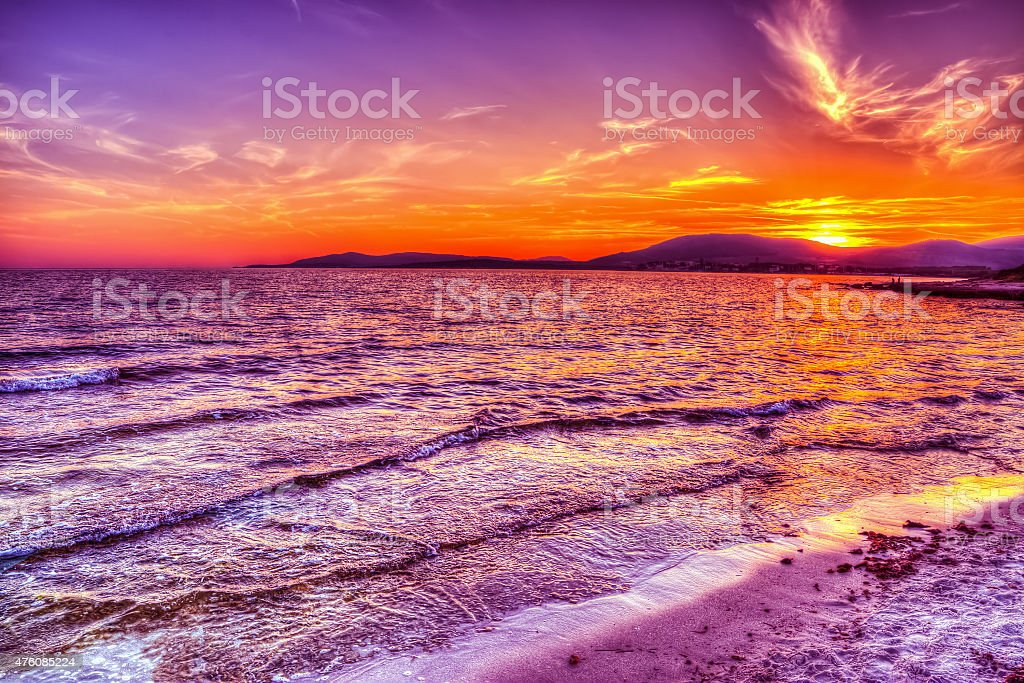 colorful sky over Alghero shore stock photo