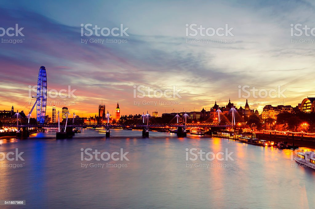 Colorful sky over Golden Jubilee Bridge at sunset stock photo