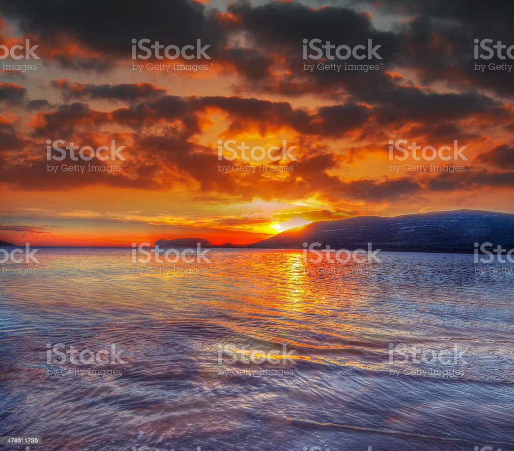 colorful sky over Mugoni beach stock photo