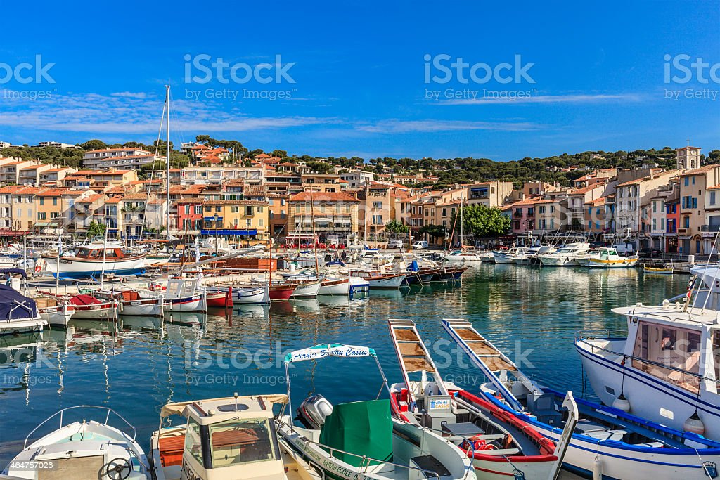 Colorful slew of boats in harbor in Cassis, France stock photo