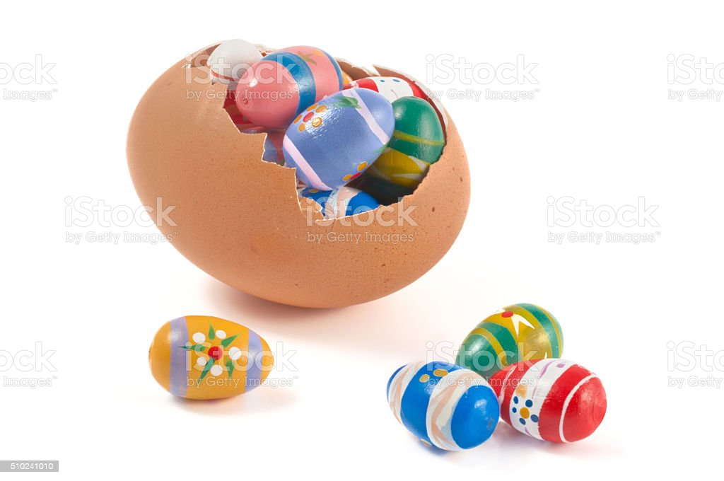 colorful small easter eggs in a big egg stock photo