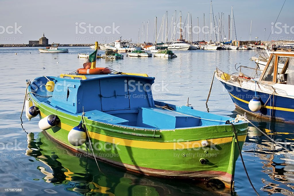 Colorful small fishing boat in Procida stock photo