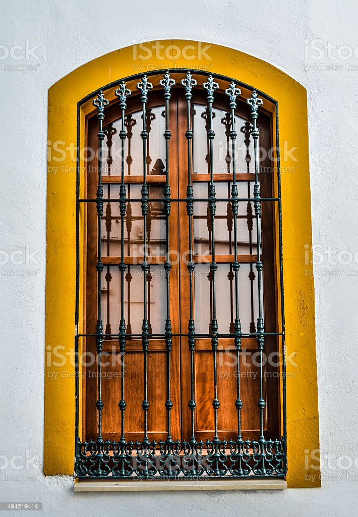 Colorful Spanish window with arches stock photo