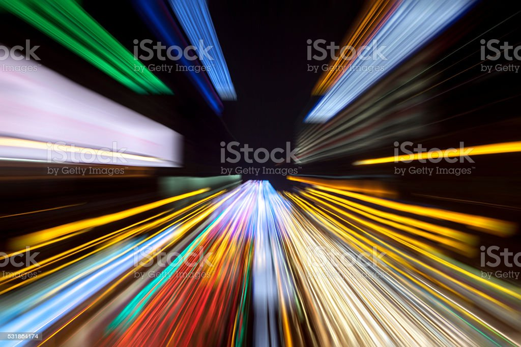 Colorful speed light trails zoom effect - speed background concept stock photo