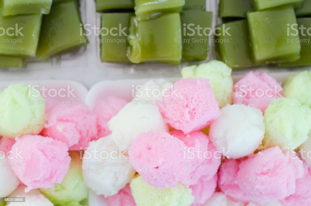 Colorful sponge cake and layer sweet cake (Kanom Chan) stock photo
