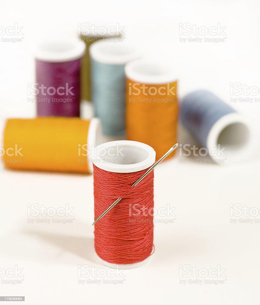 Colorful spools and needle royalty-free stock photo