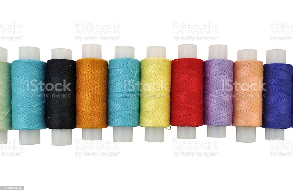 Colorful spools isolated on white background royalty-free stock photo