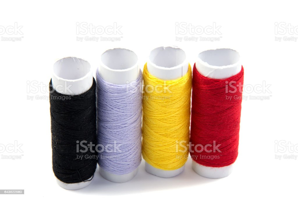 Colorful spools of thread isolated on white background stock photo