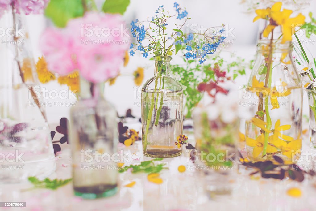 Colorful spring flowers on the table stock photo