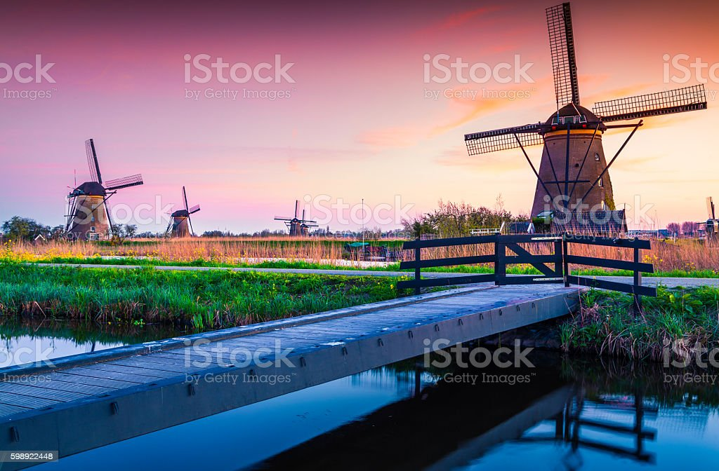 Colorful spring scene in the famoust Kinderdijk canals with wind stock photo