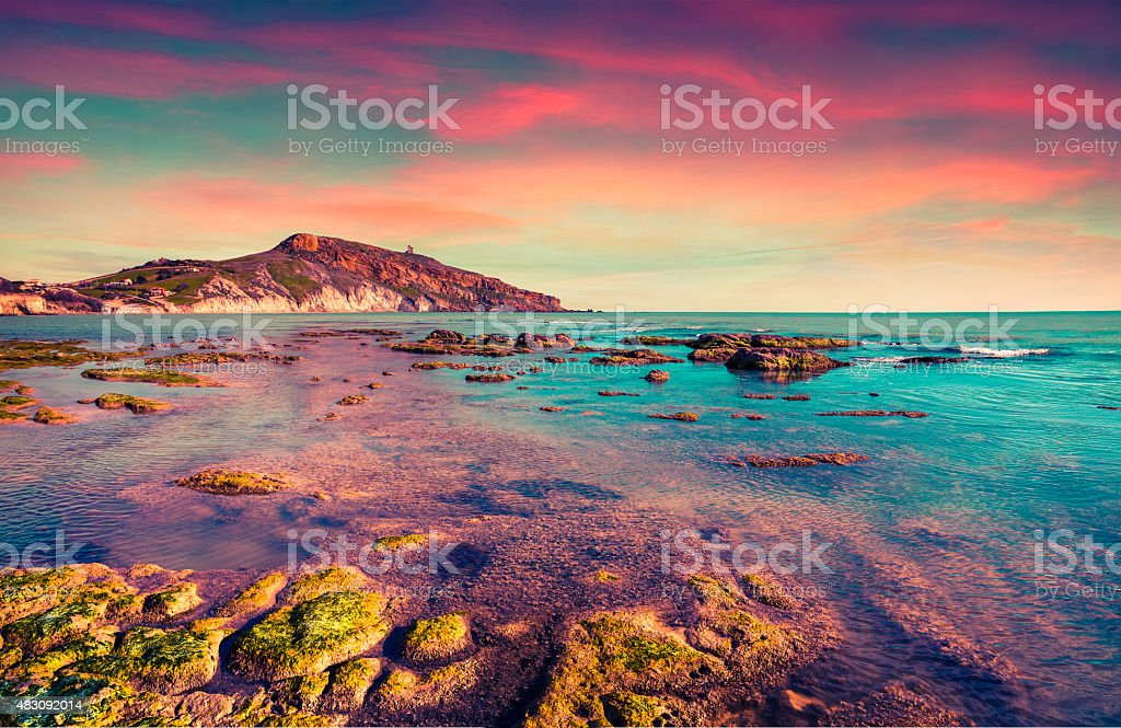 Colorful spring sunset from the Giallonardo beach stock photo