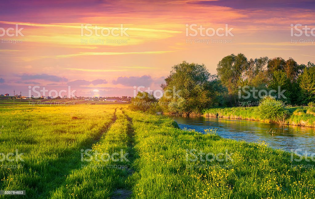 Colorful spring sunset on the river. stock photo