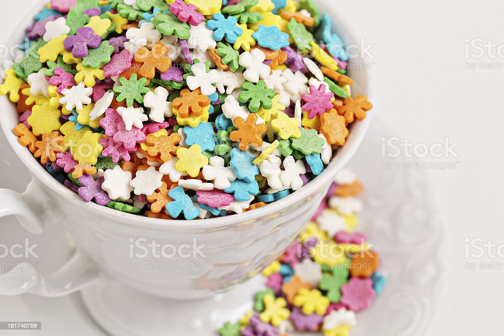 Colorful sprinkles in white cup royalty-free stock photo