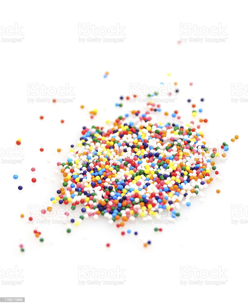 Colorful sprinkles on white background stock photo
